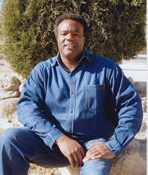 Curtis Lundy Downing in prison on February 9, 2014. Downing says that he did not have a full beard in 1993. He quit wearing facial hair in 1992. Height: 6'4'', Weight: 180 lbs, Build: medium, Ethnic: Black, dark complexion (Source: Nevada Department of Corrections)